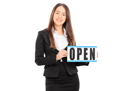 retailer: Female retailer holding an open sign isolated on white background Stock Photo