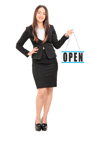 retailer: Full length portrait of a young female retailer holding an open sign isolated