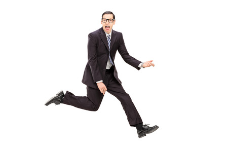 air guitar: Man in suit playing air guitar isolated