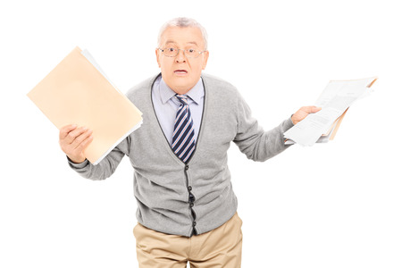 frantic: Senior man panicking with papers in his hand isolated  Stock Photo