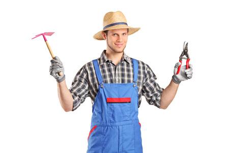 jumpsuit: Male gardener holding working tools isolated on white background Stock Photo