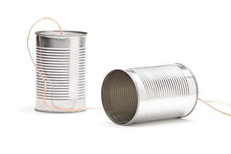 Studio shot of a tin can phone isolated on white photo