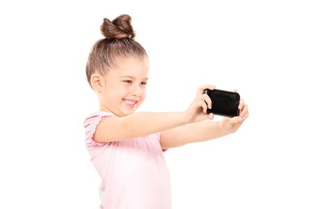little girl posing: Little girl taking a selfie isolated  Stock Photo