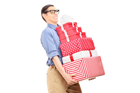 Man carrying a heavy load of gifts isolated  photo