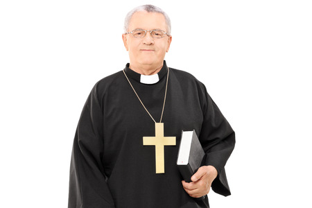 Mature priest holding a bible isolated  Stock Photo
