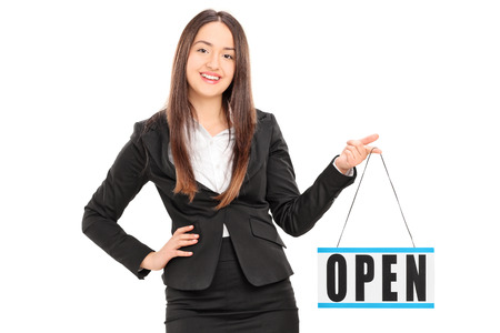 retailer: Young female retailer holding an open sign isolated