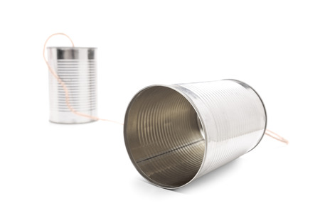 tin: Tin can phone isolated on white background connected by a gray string