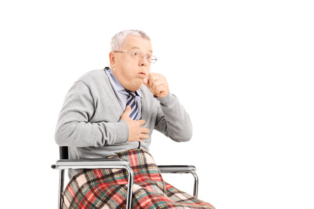 Senior man in wheelchair choking isolated on white background photo