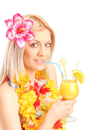Blond female drinking an exotic cocktail isolated on white background photo