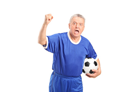 fanatic studio: Fanatic football supporter cheering isolated  Stock Photo