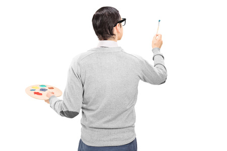 artist painting: Male artist holding a paintbrush and color pallet isolated