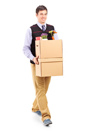 Man walking with moving boxes isolated on white background photo