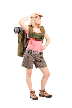 Full length portrait of a female scout with backpack isolated on white background photo