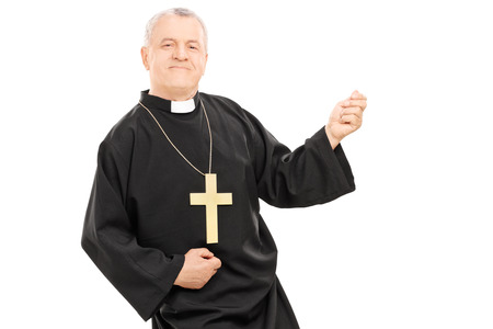 air guitar: Happy priest playing air guitar isolated against white  Stock Photo