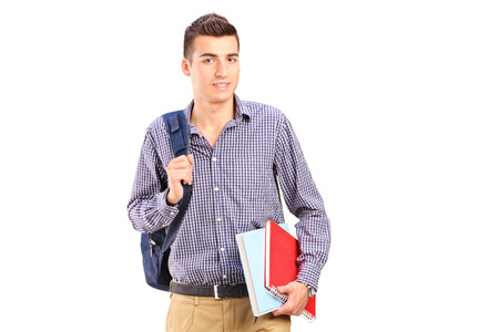 Male student walking with backpack isolated on white background photo
