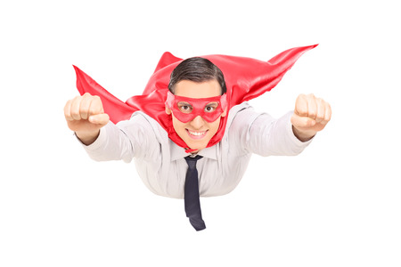 Superhero with red cape flying isolated on white background Stock Photo