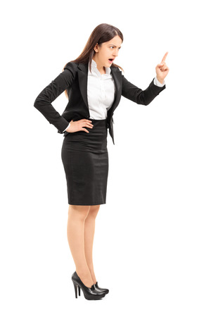 Angry businesswoman threatening with finger isolated on white background photo