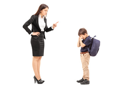 Angry mother disciplining her son isolated on white background Stock Photo