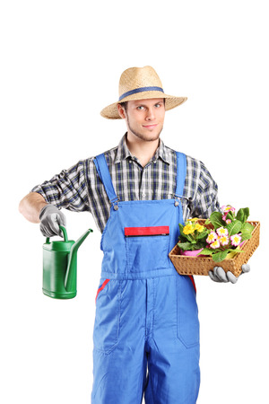 jumpsuit: Male florist holding a watering can and flowers isolated on white background