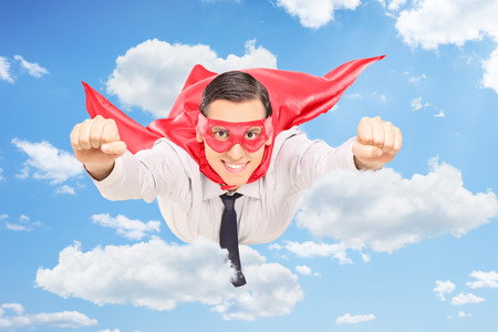 20s adult: Male hero flying through the clouds in the sky