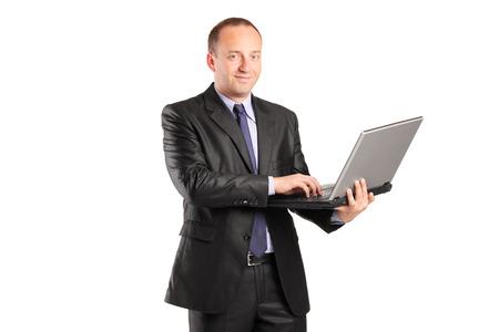 Businessman working on laptop isolated on white background photo