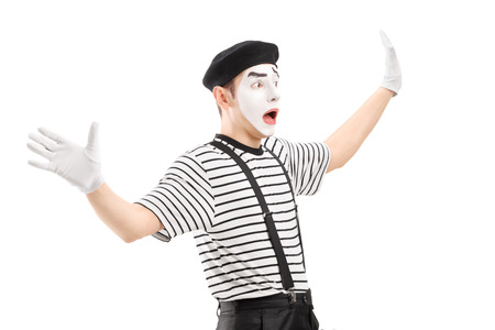 affraid: Surpised mime artist gesturing with hands, isolated on white background Stock Photo