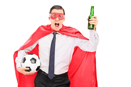 loud: Superhero holding a football and cheering isolated on white background