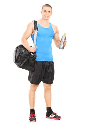 Male athlete holding a water bottle isolated on white background photo