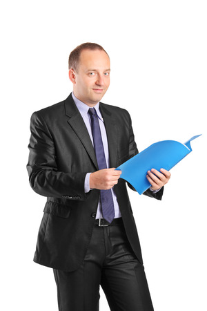 Businessman holding a folder and looking at camera isolated on white background photo
