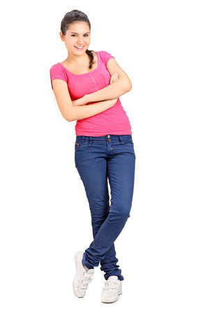 Casual girl leaning against a wall isolated on white background