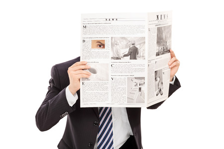 sneaky: Sneaky boss peeking through a hole in newspaper isolated on white background