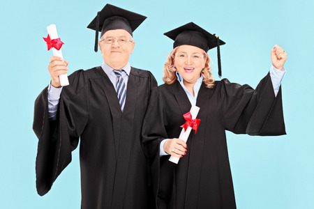 mature people: Mature people celebrating their graduation on blue background