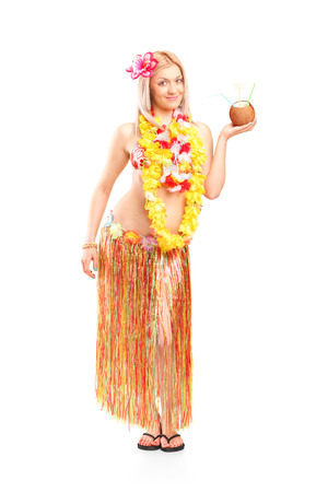 Full length portrait of a woman holding an exotic cocktail in a coconut isolated on white background photo