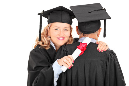 Mature female graduate hugging a man isolated on white background photo