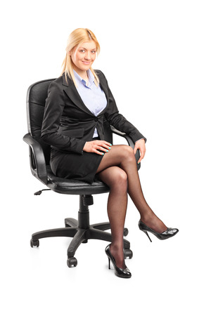 Businesswoman sitting on an office chair isolated on white background photo