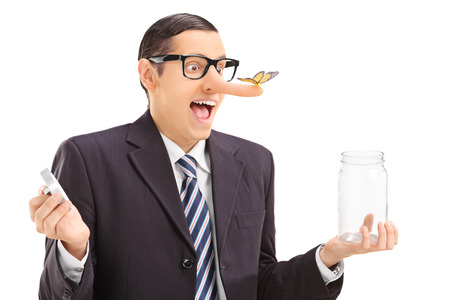 dishonest: Businessman with butterfly on his nose holding a jar isolated on white background
