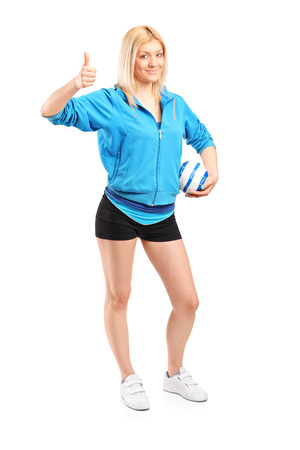 Full length portrait of a professional female handball player giving thumb up isolated on white background photo