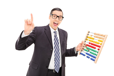 Excited businessman holding an abacus isolated on white background photo