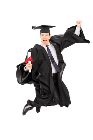 graduate hat: Male graduate student jumping out of joy isolated on white background Stock Photo