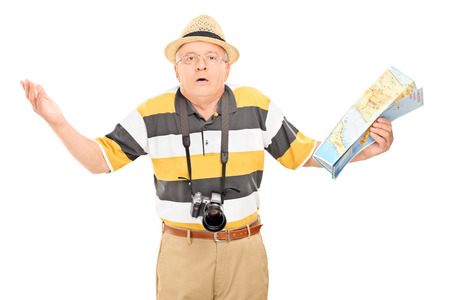 baffled: Confused mature tourist holding a map isolated on white background Stock Photo