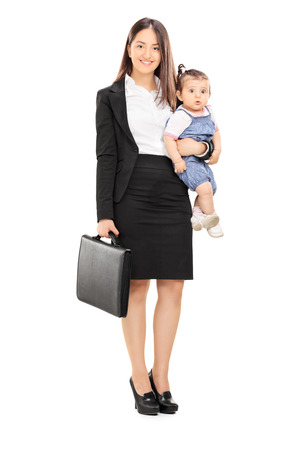 Full length portrait of a single mother holding her baby daughter isolated on white background Stock Photo
