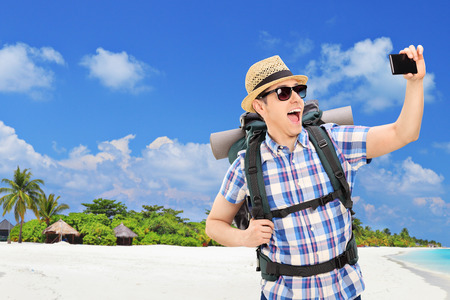 Tourist taking selfie at a tropical beach at Maldives Islands photo