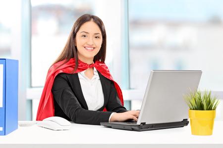 durable: Female hero working on laptop indoors Stock Photo