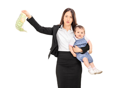 Young mother holding her baby and a stinky diaper isolated on white background Imagens