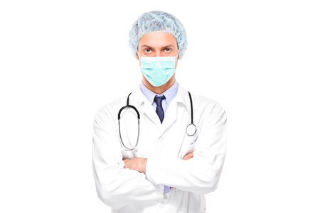 Male surgeon with face mask isolated on white background photo