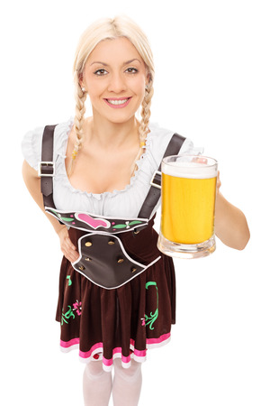 Traditional Bavarian woman holding a pint of beer isolated on white background photo