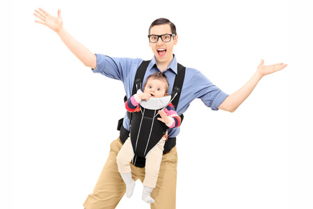 baby carrier: Young father dancing and carrying his baby daughter isolated on white background Stock Photo