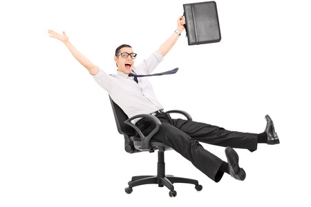 moving office: Overjoyed businessman riding in an office chair isolated on white background