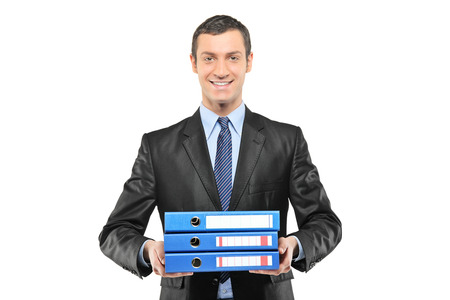 Businessman holding a bunch of folders isolated on white background photo