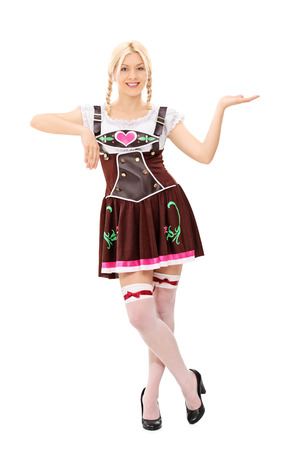 Full length portrait of a Bavarian woman holding an imaginary tray isolated on white background photo